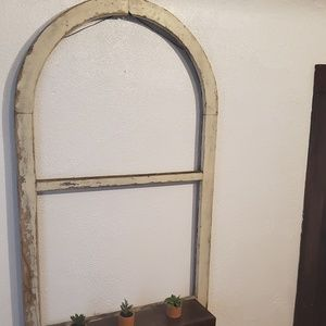 Antique arch window with built in shelving